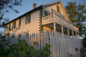 The historic McCoy House on the edge of the Old Town native plant landscape